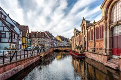 Partially wooden traditional family of Alsace houses. Partially wooden traditional architectural family of Alsace houses alongside a canal in Petite France Royalty Free Stock Photo