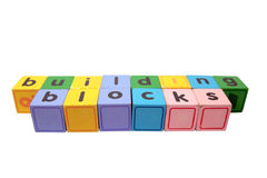 Particelle elementari nei caratteri in grassetto del gioco di legno Fotografia Stock