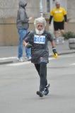 Particiant maratona senior. Fotografia Stock