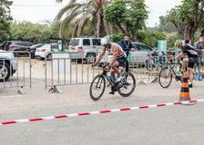 Participant of the annual triathlon starts from the start in the Stock Photo