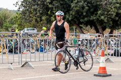Participant of the annual triathlon starts from the start in the Royalty Free Stock Image