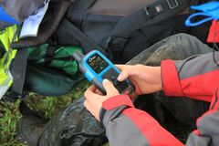 Participant checks his Iridium tracker at a checkpoint during the Ten Tors event on Dartmoor royalty free stock photos