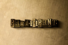 PARTICIPANT - close-up of grungy vintage typeset word on metal backdrop Stock Photography