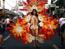A participant in her colorful costume at a parade during the Sumaka Festival in Antipolo City. ANTIPOLO CITY, PHILIPPINES - MAY 1, 2017: A participant in her stock image