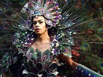 A participant in her colorful costume at a parade during the Sumaka Festival in Antipolo City. ANTIPOLO CITY, PHILIPPINES - MAY 1, 2017: A participant in her stock photography