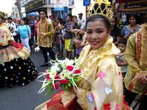 A participant in her colorful costume at a parade during the Sumaka Festival in Antipolo City. ANTIPOLO CITY, PHILIPPINES - MAY 1, 2017: A participant in her royalty free stock photos