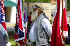 Participant Holding Rebel Flag During Ceremony Stock Photo