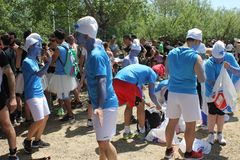 Participant at Inferno Run 2015 near Florence, funny dressed as smurfs Royalty Free Stock Image