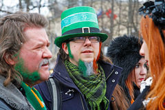 Participant in the Irish hat and with beard the color of the Irish flag at the St. Patrick`s Day Parade in the park Sokolniki in M Royalty Free Stock Photos