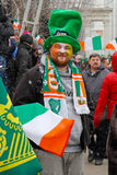 Participant in the Irish hat and scarf at the St. Patrick`s Day Parade in the Irish hat Stock Photos