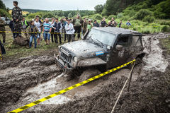 Participant on Jeep passes a deep muddy pit. Royalty Free Stock Photo