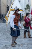 Participant of medieval costume party. Taggia, Italy - March 17, 2018: Participant of medieval costume party in the historic city of Taggia in Liguria region of stock photos