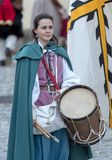 Participant of medieval costume party. Taggia, Italy - March 17, 2018: Participant of medieval costume party in the historic city of Taggia in Liguria region of stock photography