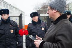 Participant of mourning march of memory of Boris Nemtsov and police Royalty Free Stock Photos