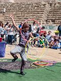 A participant of the Purim festival juggles with hoops for visitors in Caesarea, Israel. Caesarea, Israel, March 03, 2018 : A participant of the Purim festival Stock Images