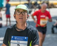 Participant of the Regensburg Marathon 2018 at the old city hall - Regensburg, Germany stock image