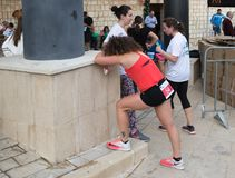 The participant rests at the finish after the annual race `Cristmas Run` in Mi`ilya in Israel Royalty Free Stock Photo