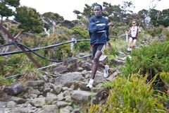 Participant running down Mt Kinabalu Royalty Free Stock Photo
