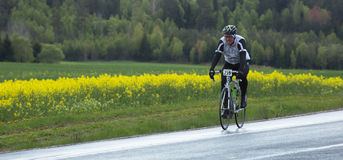 A participant in a smaller bike race for both professionals and Stock Photography