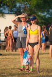 A participant and a spectator before the start of a triathlon Stock Photography