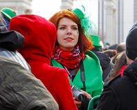 Participant at the St. Patrick`s Day Parade in the Irish hat in the park Sokolniki in Moscow Royalty Free Stock Photo
