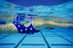 Participant Swimming Underwater Stock Image