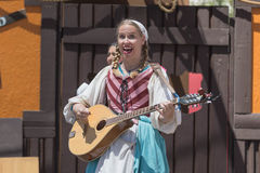 Participant wearing typical clothes, singing and playing Royalty Free Stock Photo
