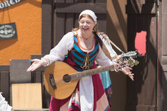 Participant wearing typical clothes, singing and playing Stock Photography