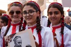 Participantes del regimiento inmortal - acción pública, durante la cual los participantes llevaron banderas Foto de archivo libre de regalías