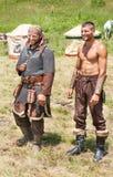 Participantes do festival popular em Bulgária nos trajes eslavos velhos Imagem de Stock Royalty Free