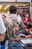 Participantes en el 10mo convenio internacional del tatuaje en centro de la Congreso-EXPO Imagen de archivo libre de regalías