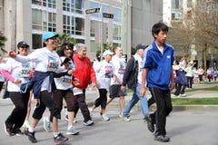 Participantes felices del funcionamiento de Vancouver Sun Foto de archivo libre de regalías