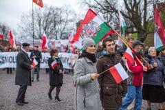 Participantes que celebran Día de la Independencia nacional una República de Polonia Imagen de archivo libre de regalías