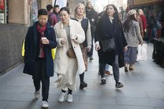 Stylish attendees gathering outside 180 The Strand for London Fashion Week
