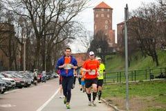 Participants during the annual Krakow international Marathon. Royalty Free Stock Image
