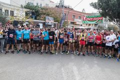 Participants of the annual race `Cristmas Run` are waiting for the start  in Mi`ilya in Israel Royalty Free Stock Images