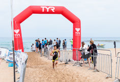 Participants of the annual triathlon finish in the swim in the M royalty free stock photography