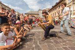 Participants at the annually (Jul 9-12) 28th International Festival of Street Theatres. KRAKOW, POLAND - JUL 12, 2015: Participants at the annually (July 9-12) Royalty Free Stock Photography