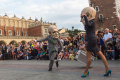 Participants at the annually (Jul 9-12) 28th International Festival of Street Theatres. KRAKOW, POLAND - JUL 12, 2015: s - Teatr KTO (PL) Peregrinus in Main royalty free stock photography