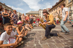 Participants at the annually (July 9-12) 28th International Festival of Street Theatres. KRAKOW, POLAND - JUL 12, 2015: Participants at the annually (July 9-12) Royalty Free Stock Photo