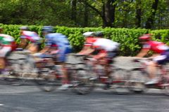 MOSCOW, RUSSIA - 6 May 2002: Cycling marathon, in the streets of the city. Blurred motion with green bushes in focus royalty free stock photography