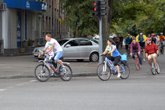 Participants bike ride with Ukrainian flags Stock Photos
