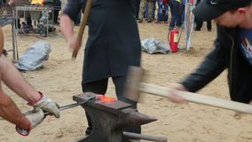Participants of blacksmiths competition work stock video footage