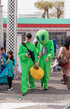 Participants in carnival in aliens costumes are walking along s royalty free stock images