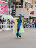 Participants at carnival on stilts are walking along the street Royalty Free Stock Image