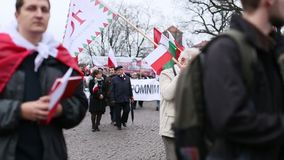 Participants celebrating National Independence Day an Republic of Poland - is a public holiday. KRAKOW, POLAND - NOV 11, 2015: Unidentified participants stock footage