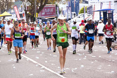 Participants Competing in the 2014 Comrades Marathon Road Race Royalty Free Stock Photos