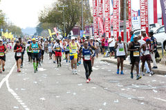 Participants Competing in the 2014 Comrades Marathon Road Race Royalty Free Stock Images