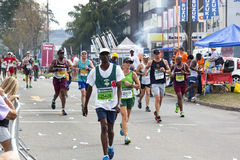 Participants competing in 2014 Comrades Marathon Road Race Stock Images