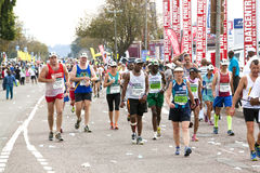 Participants competing in 2014 the Comrades Marathon Road Race Stock Photos